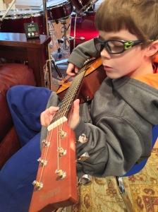 """Nick perfecting his """"guitar face"""" on his Yamaha guitar"""